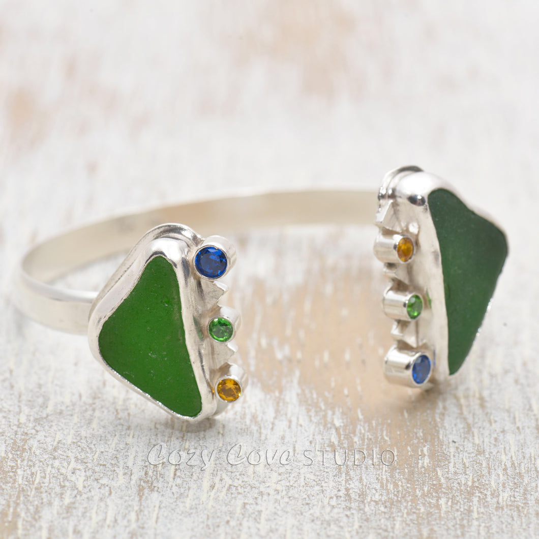 Cuff bracelet with kelly green sea glass accented with sparkly cubic zirconias in a hand crafted setting of tarnish resistant sterling silver. (B484)