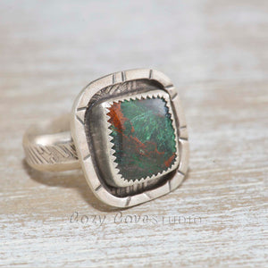 Statement ring with a cupric malachite cabochon in a hand crafted setting of tarnish resistant sterling silver. (R488)