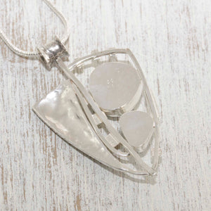 Sea glass statement pendant necklace in a sterling silver setting accented with 22 karat gold. (N505)