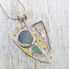 Load image into Gallery viewer, Sea glass statement pendant necklace in a sterling silver setting accented with 22 karat gold. (N505)