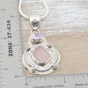 Boho style sea glass pendant with rare pink sea glass in a hand crafted sterling silver setting accented with sparkly CZs. (N511)