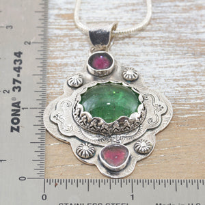Boho style pendant necklace with a large green tourmaline in  hand crafted sterling silver setting accented with watermelon tourmaline slices. (N513)