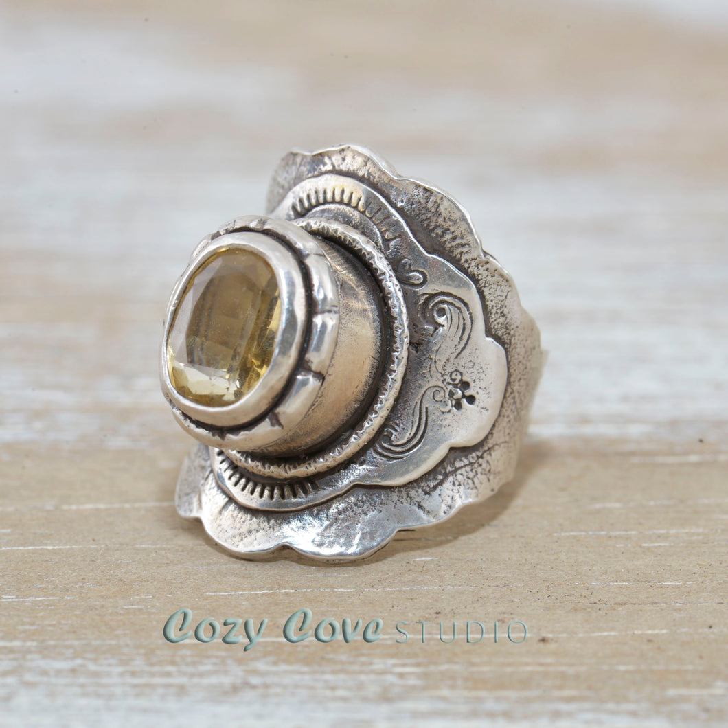Boho style ring with a sparkly golden topaz in a hand crafted setting of sterling silver. (R516)
