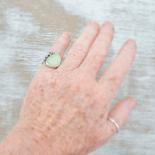 Load image into Gallery viewer, Sea glass ring with pale green sea glass accented with  a sparkly peridot in sterling silver. (R528)