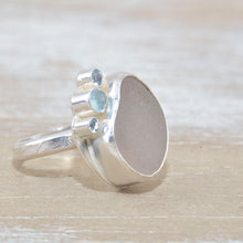 Load image into Gallery viewer, Sea glass ring  accented with an aquamarine and sparkly cubic zirconias  in sterling silver. (R533)