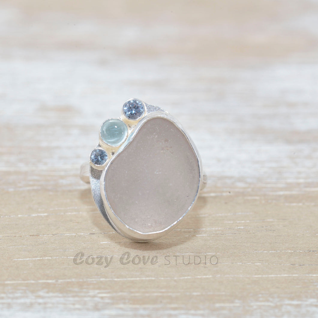 Sea glass ring  accented with an aquamarine and sparkly cubic zirconias  in sterling silver. (R533)