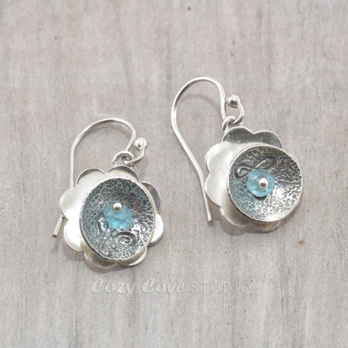Handmade sterling silver earrings accented with an aqua apatite bead.