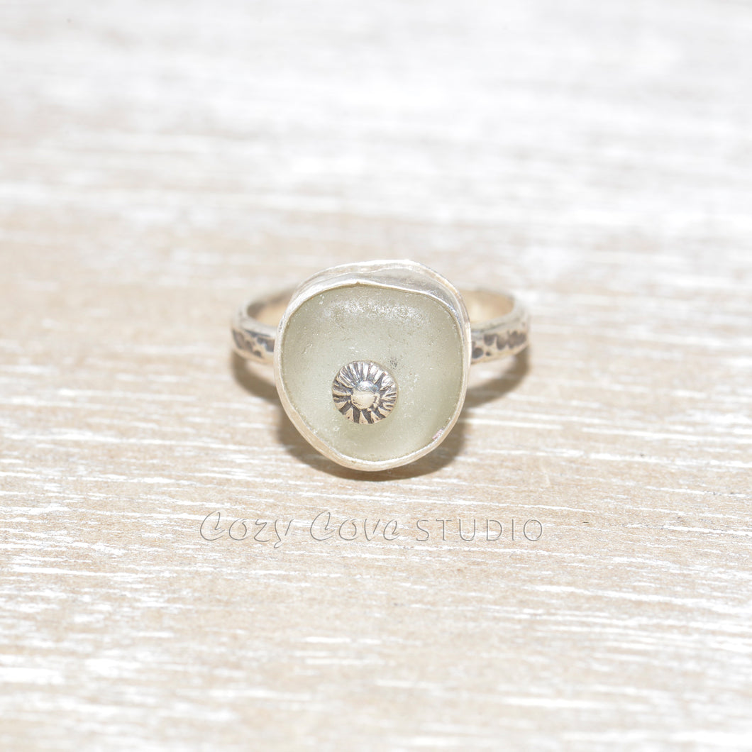 Sea glass ring with a hand crafted stud in a setting of fine and sterling silver. (R558)