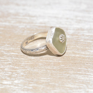 Sea glass ring with a hand crafted stud in a setting of fine and sterling silver. (R559)
