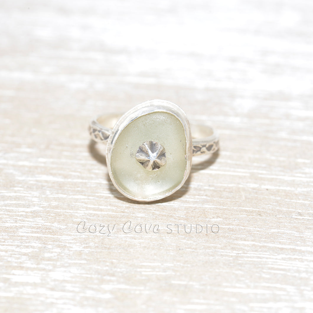 Sea glass ring with a hand crafted stud in a setting of fine and sterling silver. (R560)
