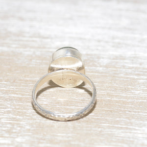Sea glass ring with a hand crafted stud in a setting of fine and sterling silver. (R562)