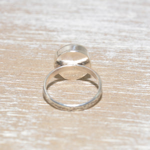 Sea glass ring with a hand crafted stud in a setting of fine and sterling silver. (R563)