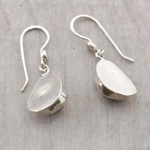 Sea glass earrings in pale green accented with sterling silver studs. (E577)