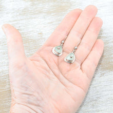 Load image into Gallery viewer, Sea glass earrings in pale green accented with sterling silver studs. (E577)