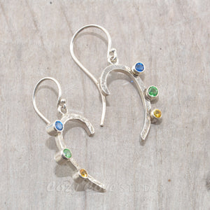 Sparkly dangle earrings with colorful cubic zironias in hand crafted settings of sterling silver.