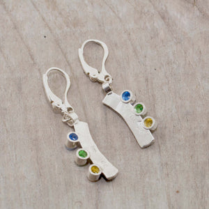 Sparkly dangle earrings with colorful cubic zironias in hand crafted settings of sterling silver. (E583)
