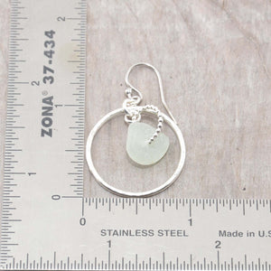Pale green sea glass earrings encircled by textured hoops of sterling silver. (E586)