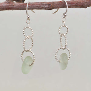 Sea glass dangle earrings on circle of sterling silver beaded wire. (E594)