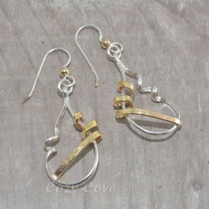 Mixed metal dangle earrings in sterling silver and 14K gold fill.