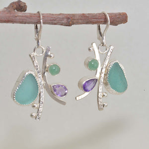Sea glass and semi-precious stone earrings in hand crafted settings of tarnish resistant sterling silver. (E607)