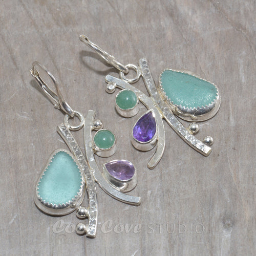 Sea glass and semi-precious stone earrings in hand crafted settings of tarnish resistant sterling silver.