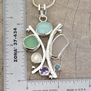 Sea glass statement pendant necklace in a hand crafted setting of tarnish resistant sterling silver accented with semi-precious gemstones. (N608)