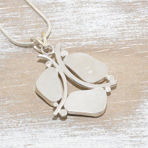 Sea glass pendant necklace in sterling silver accented with 24K gold overlay. (N609)