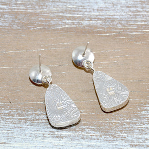 Sea glass earrings in hand crafted sterling silver settings accented with semi-precious gemstones of pale blue topaz (E616)