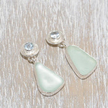 Load image into Gallery viewer, Sea glass earrings in hand crafted sterling silver settings accented with semi-precious gemstones of pale blue topaz