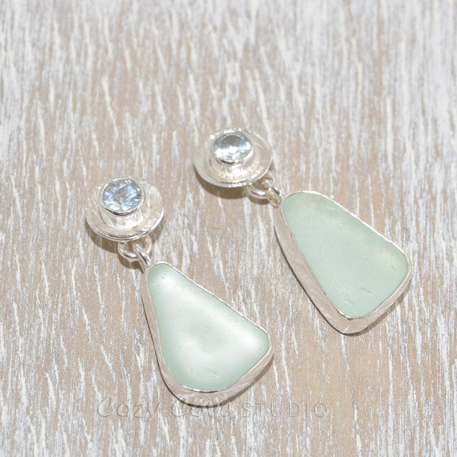 Sea glass earrings in hand crafted sterling silver settings accented with semi-precious gemstones of pale blue topaz