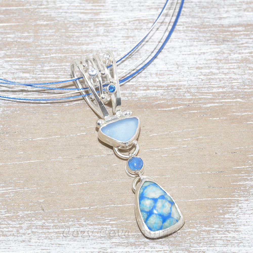 Sea glass and enamel pendant necklace in shade of blue  in a hand crafted setting of sterling silver. (N618)
