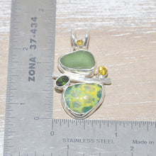 Load image into Gallery viewer, Sea glass and vitreous enamel pendant necklace in shades of yellow and green in a handcrafted setting of sterling silver accented with semi-precious gemstones. (N621)