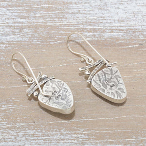 Sea glass earrings in hand crafted sterling silver settings. (E627)
