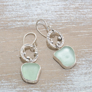 Sea glass earrings in hand crafted sterling silver settings.