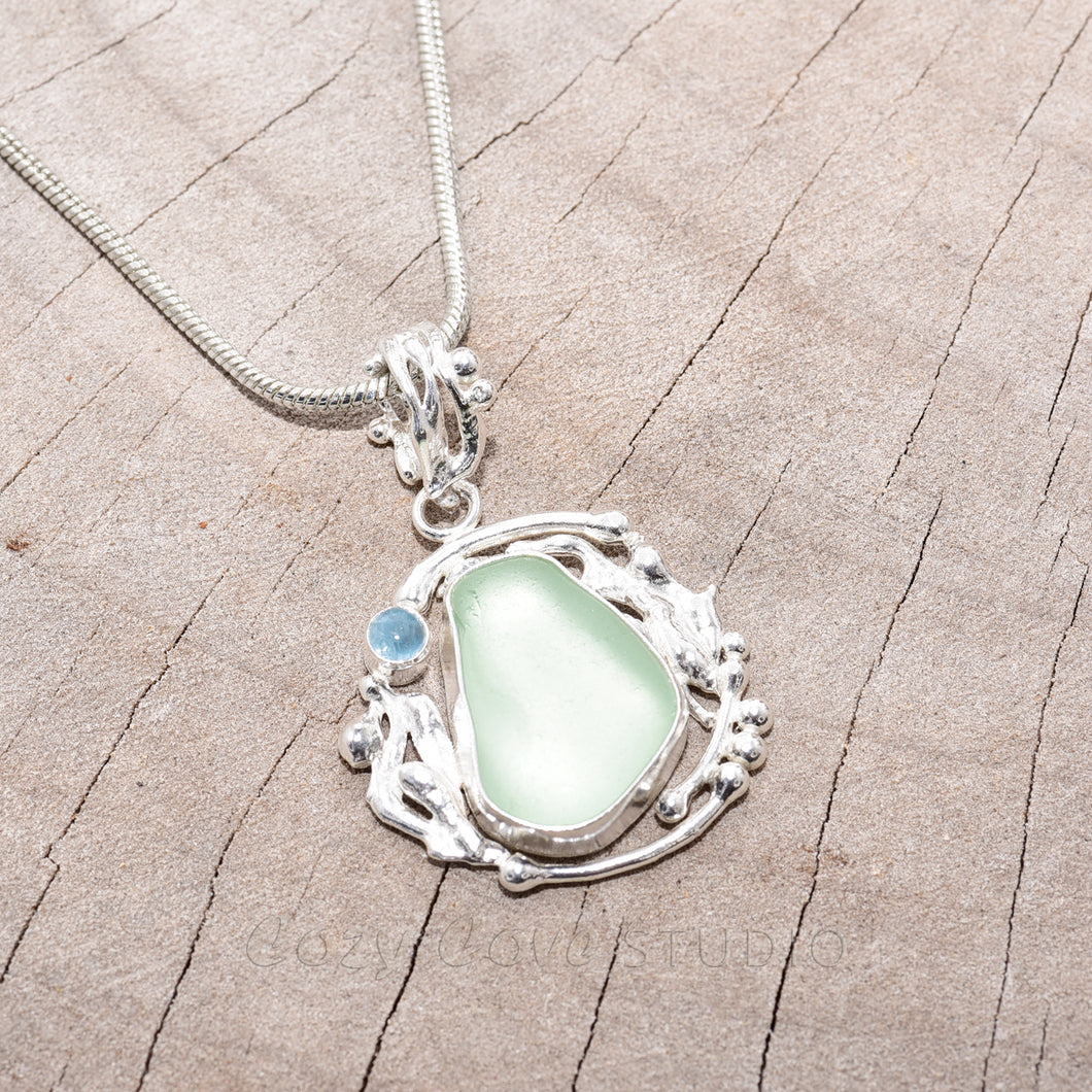 Sea glass necklace in a hand crafted sterling silver setting. (N633)
