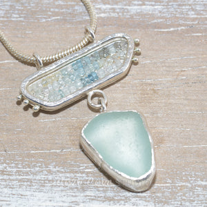 Sea glass pendant necklace in a hand crafted sterling silver setting accented with beryl and aquamarine beads (N636)