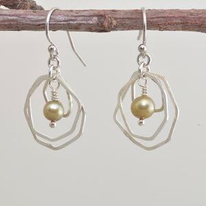 Dangle earrings with green cultured pearls in sterling silver. (E644)