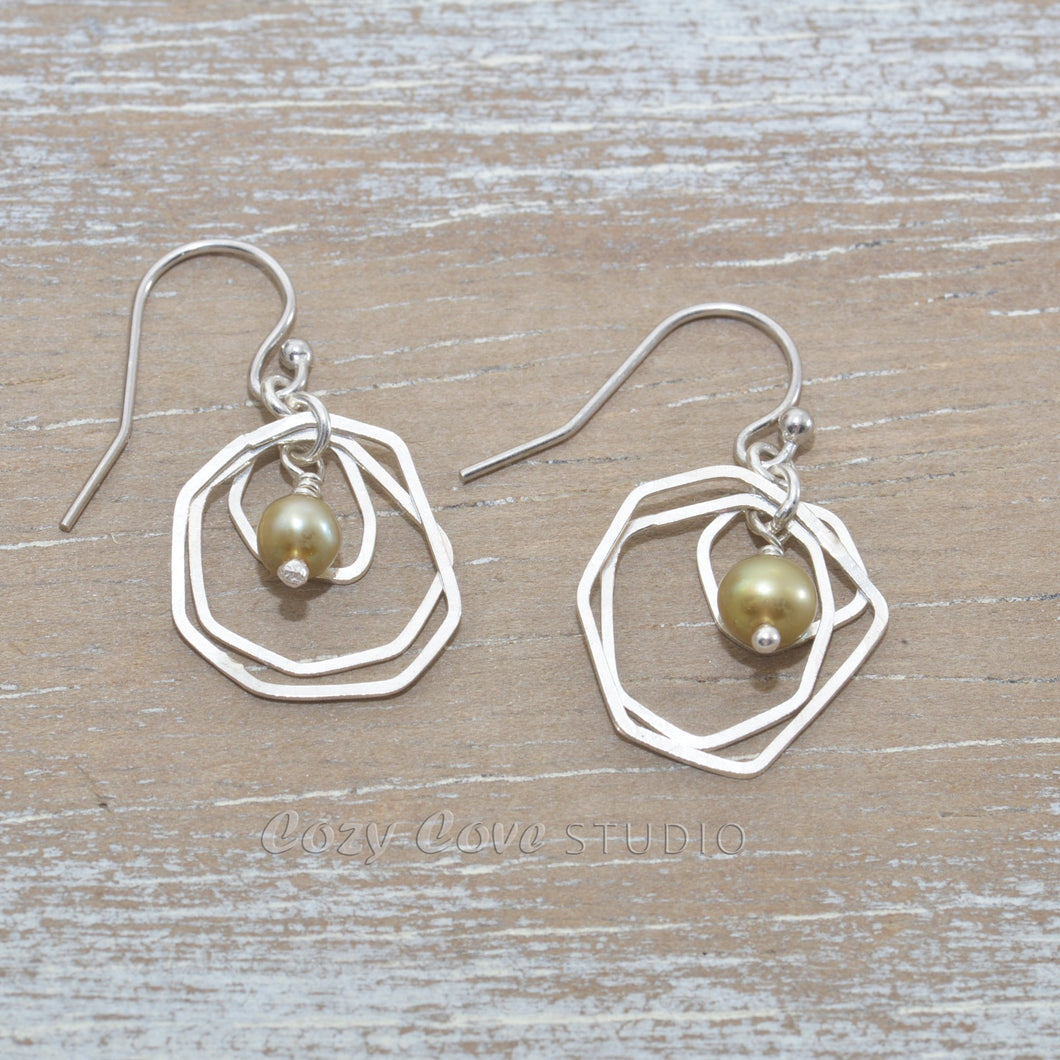 Dangle earrings with green cultured pearls in sterling silver.