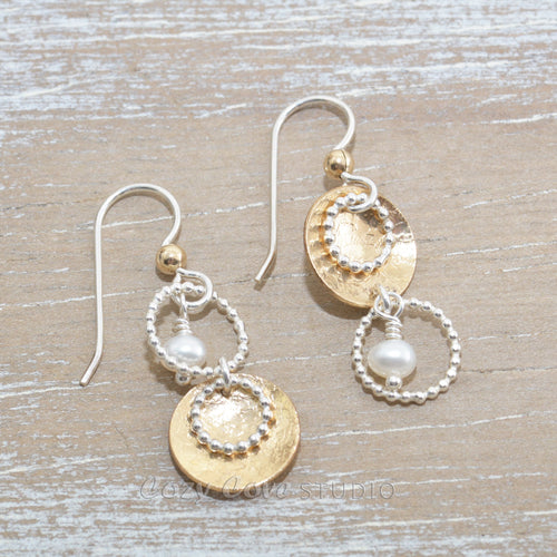 Asymetric dangle earrings in sterling silver and 14K gold fill with cultured pearl dangles.
