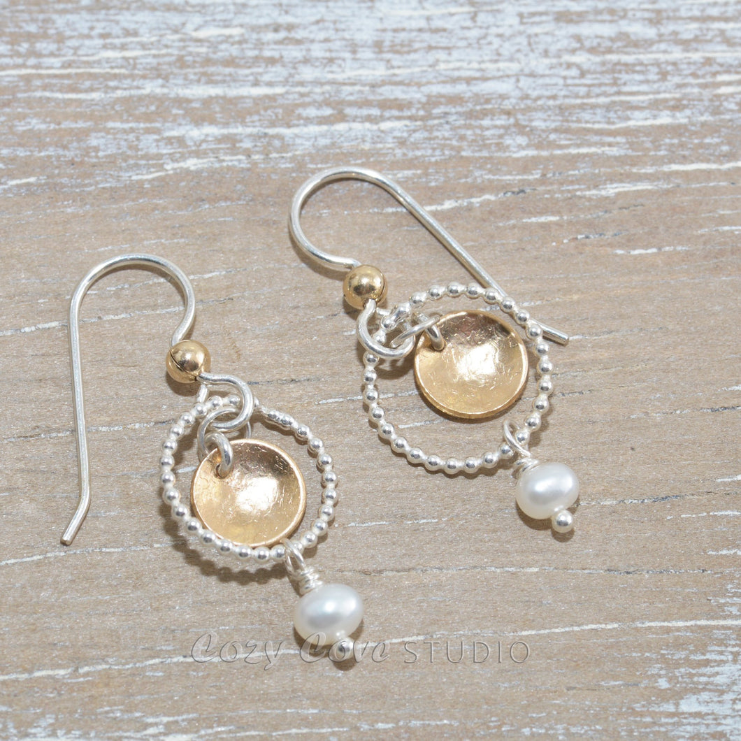 Dangle earrings in sterling silver and 14k gold fill with cultured pearls.
