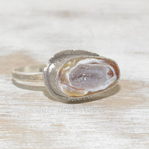 Druzy geode cuff bracelet in a hand crafted setting of sterling silver. (B664)