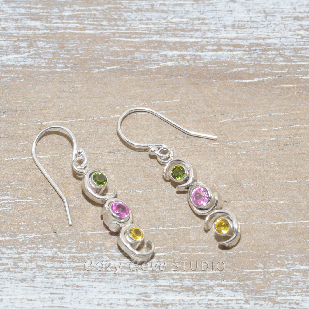 Sparkly dangle earrings in hand crafted sterling silver settings.