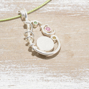 Dichroic glass necklace in a hand crafted setting of sterling silver. (N674)