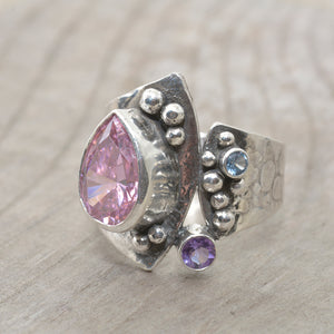 Artisan ring with a sparkly pear shaped cubic zirconia in a hand crafted setting of tarnish resistant sterling silver. (R679)