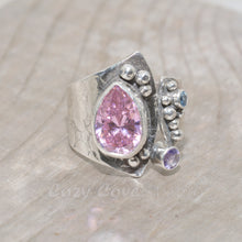 Load image into Gallery viewer, Artisan ring with a sparkly pear shaped cubic zirconia in a hand crafted setting of tarnish resistant sterling silver. (R679)