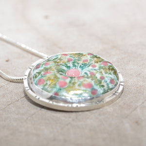 Enamel sea urchin pendant necklace accented with a gemstone in a hand crafted sterling silver setting. (N684)