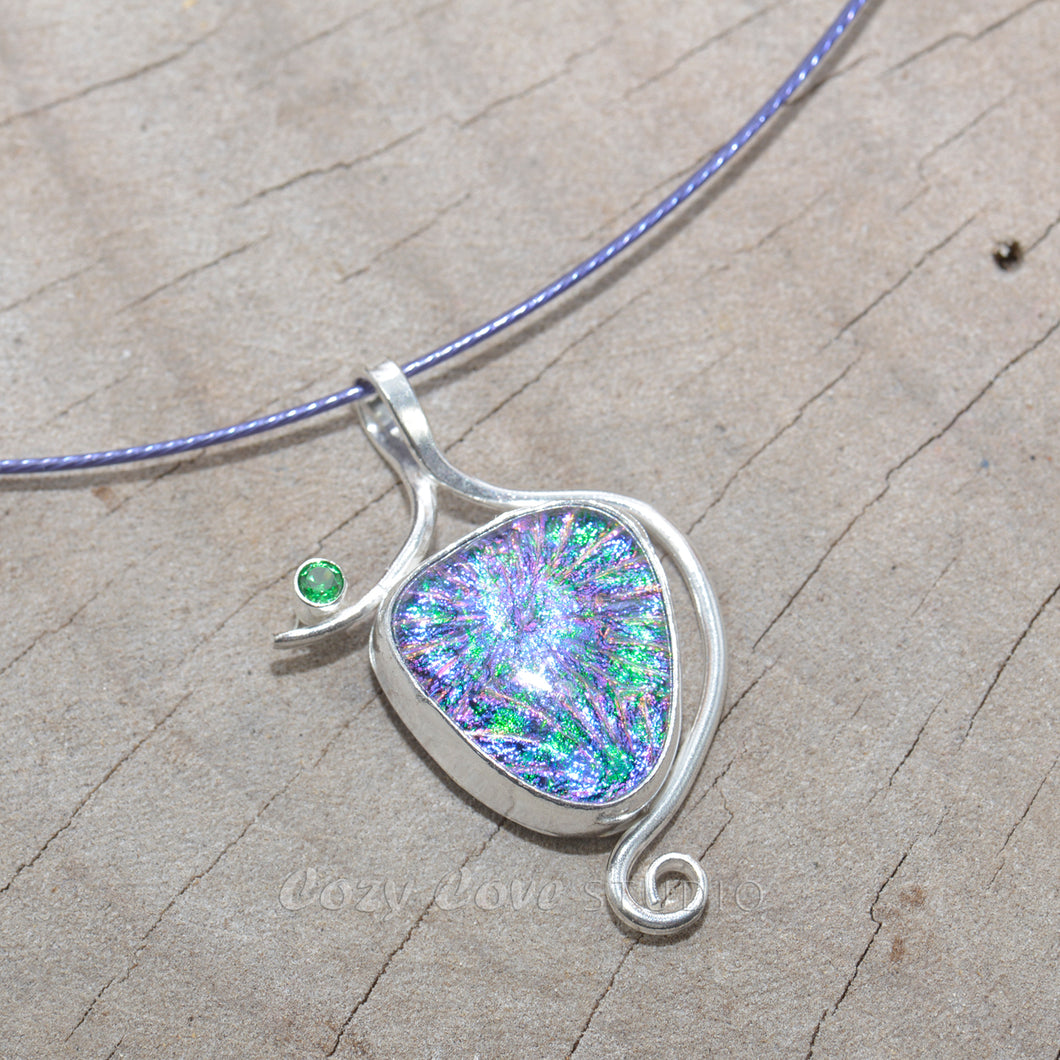 Dichroic glass pendant necklace in a hand crafted setting of sterling silver.