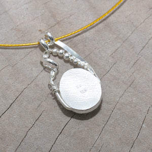 Dichroic glass pendant necklace in a hand crafted setting of sterling silver. (N693)