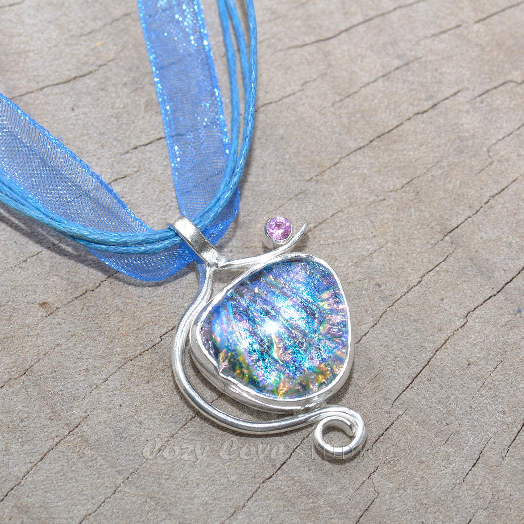 Dichroic glass pendant necklace in a hand crafted setting of sterling silver. (N694)