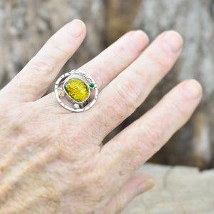 Dichroic glass ring in tones of green and yellow  in a hand crafted setting of sterling silver. (R700)